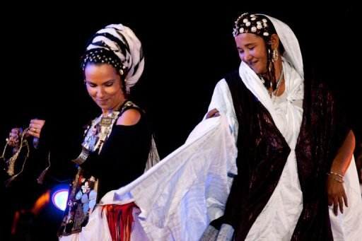 "Moroccan singer Oum (left) and Malian singer Fadimata Walett Oumar perform at Taragalte music festival in M'hamid El Ghizlane near Zagora Nov.10. Rousing desert rhythms brought to life oasis, last stop in Morocco before Sahara, as musicians gathered from across region to send ""message of solidarity to the musicians and the women of Mali."""
