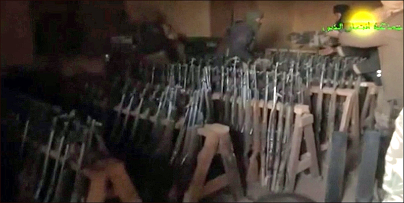 From Ansar al-Din video earlier this year showing Amashash military garrison filled with weapons (AFP/Ansar al-Din).