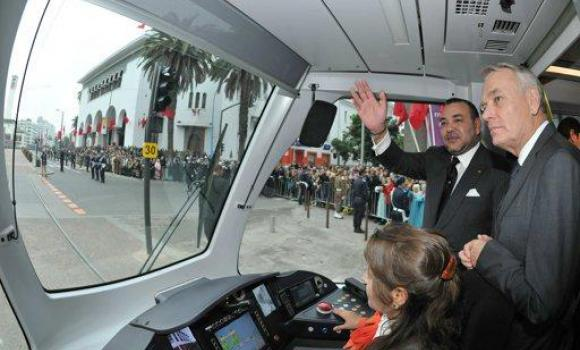 French Prime Minister Jean-Marc Ayrault and Moroccan King Mohamed VI travel together during the inauguration of Tramway