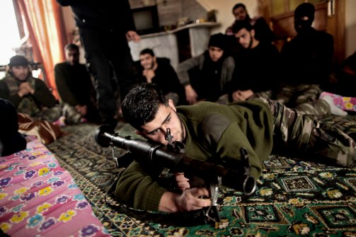 Syrian rebels listen to their trainer while teaching them how to use the RPG during a training session in Maaret Ikhwan, near Idlib, Syria on Dec. 17, 2012. The training is part of an attempt to transform the rag-tag rebel groups into a disciplined fighting force. (Muhammed Muheisen)