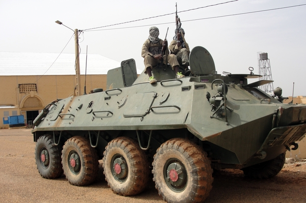 Fighters of al-Qaeda Islamist group, the Movement for Oneness and Jihad in West Africa (MUJAO) guard tank abandoned by Malian army. AFP/Getty