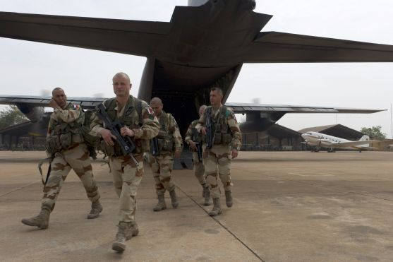"French legionnaires exit military plane at Bamako airport, Mali. France's Defense Ministry says the country will ""gradually deploy"" a total of 2,500 troops, and French president says military operation will last until security has been restored and African forces can to take charge. (AP)"
