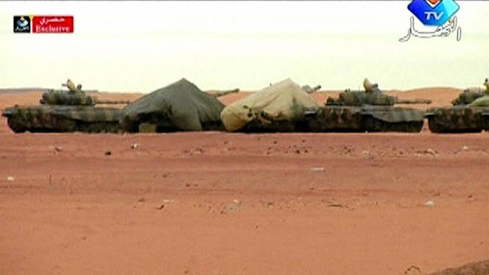 Algerian army forces surrounded site of hostage taking at gas field in Sahara desert.
