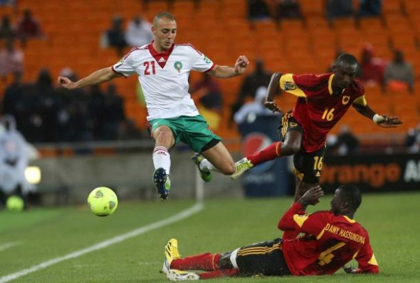 Morocco's Nordin Amrabat, top left, is challenged by Angola's Massunguna Afonso, bottom, and teammate Pirolito Panzo, top right, during their African Cup of Nations group A soccer match