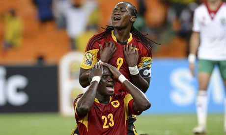Angola's forwards Manucho (top) and Guilherme Afonso react as chances go begging against Morocco. Photograph: Francisco Leong/AFP/Getty Images