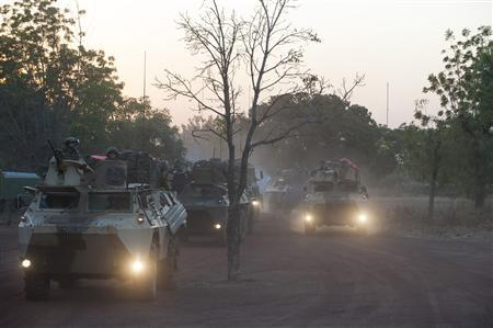 French armoured vehicles make their way north of Bamako to engage al-Qaeda-linked fighters in Mali/Reuters