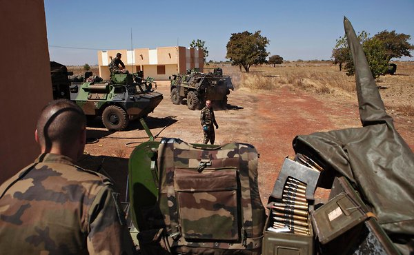 As France fortified its ground forces in Mali, French soldiers refueled armored personnel carriers, newly arrived from Ivory Coast, at a Bamako air base on Tuesday. Joe Penney/Reuters