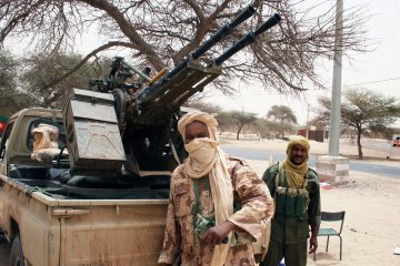 In this Wednesday, April 11, 2012 photo, Tuareg separatist rebels from the NMLA (National Movement for the Liberation of the Azawad) stand near their vehicle in Timbuktu, Mali. AP