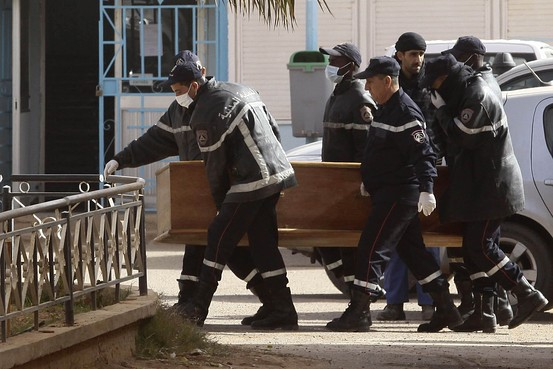 Rescue workers carry the coffin of one of the hostages killed during the hostage crisis. Reuters