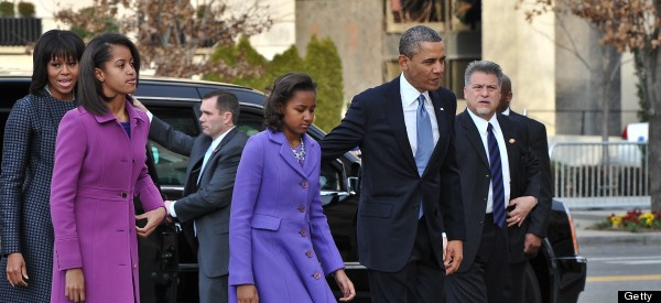 US President Barack Obama, First Lady Michelle Obama and their daughters Sasha(2nd-R) and Malia arrive at St. John's Church on January 21, 2013 in Washington, DC, hours before Obama participates in a ceremonial swearing in for a second term in office.  (NICHOLAS KAMM/AFP/Getty Images)