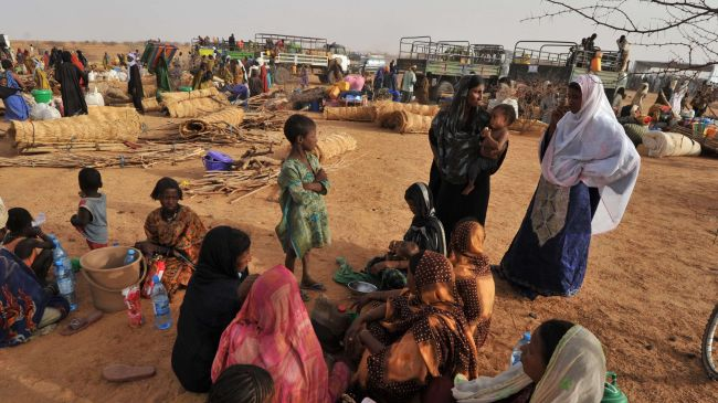 Thousands of people have been forced to flee their homes amid the conflict in Mali. Photo shows Malian refugees from north arriving at UNHCR Imbaidou camp, near Ayorou, northwest of Niamey in Niger. Development assistance will be critical for bringing stability to the region. Press TV