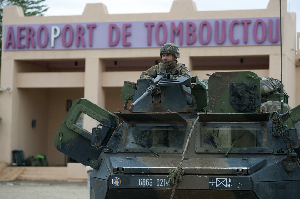 French soldier guards airport at Timbuktu in northern Mali on Monday, prior to French and Malian forces entering the ancient city. Arnaud Roine; EMA-CPAD/Associated Press