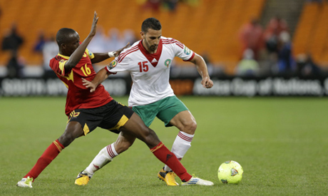 Morocco's Abdelhamid El Kaoutari, right, is challenged by Angola's 'Pirolito' Panzo during their African Cup of Nations Group A soccer match in Johannesburg, South Africa, Saturday, Jan. 19, 2013.