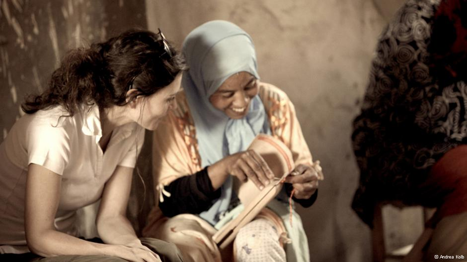 Abury founder Andrea Kolb (left) talks with a Berber sewer in Morocco