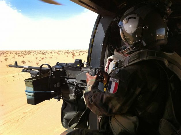 French helicopter flies towards the remote desert city of Tesalit, northern Mali. President of the government body representing the area of Tessalit, Aicha Belco Maiga confirmed by telephone on Friday from her home in Bamako that her town had been retaken by French forces. (AP)