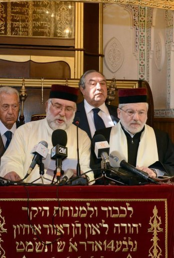 Rabbis pray as the Mayor of Fez and Secretary General of the Istiqlal Party, Hamid Chabat listen during inauguration of the Slat al Fassayine synagogue in the city of Fez (AFP)