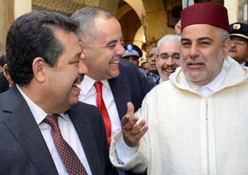 Moroccan Prime Minister Abdelilah Benkirane (R), the Mayor of Fez and Secretary General of the Istiqlal Party Hamid Chabat (L), and a security official (C) speak following the inauguration of the Slat Alfassiyine synagogue. AFP
