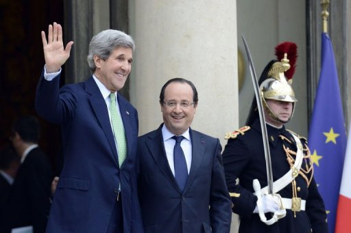 US Secretary of State John Kerry waves as he leaves the presidential Elysee palace in Paris after meeting French President Francois Hollande on February 27, 2013. Kerry met Hollande to discuss the crisis in Mali on the third leg of a European tour so far dominated by the Syrian conflict. - AFP Bertrand Guay