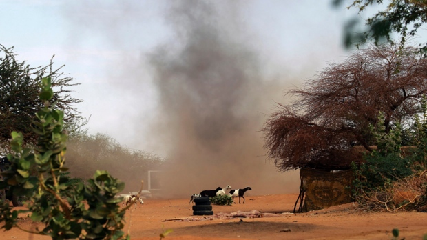 French soldiers detonate three grenades in a controlled explosion in the area where a suicide bomber exploded at the entrance of Gao, northern Mali, Sunday Feb. 10, 2013. It was the second time a suicide bomber targeted the Malian army checkpoint in three days. (Jerome Delay/AP)