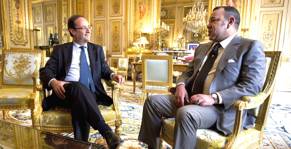 Towards strengthening solid friendship bonds: Morocco's King Mohammed VI (right) and French President Francois Hollande. Analysts say Hollande's visit to Morocco is political and economic in nature, as France seeks to develop its relations with its biggest trading partner outside the European Union.
