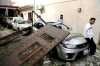 Car bomb targets French Embassy in Libya: A car bomb targets the French Embassy in Libya's capital Tuesday, wounding three people. The bombing was the first such assault on an embassy in Tripoli. (AP Photo/Abdul Majeed Forjani)