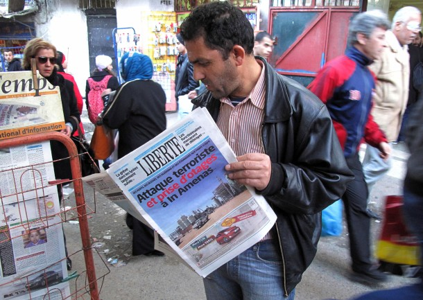 "A man reads a newspaper headlined ""Terrorist attack and kidnapping in In Amenas"" in January at a newsstand in Algiers. (Ouahab Hebbat/Associated Press)"