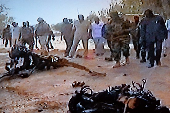 """Wreckage of suicide bomber's vehicle at Niger army base. Belmokhtar's group reportedly jointly led Niger attacks with al-Qaeda splinter group MUJAO. """"We attacked France, & Niger because of its co-operation with France, in the war against Sharia,""""said Abu Walid Sahraoui, MUJAO"""