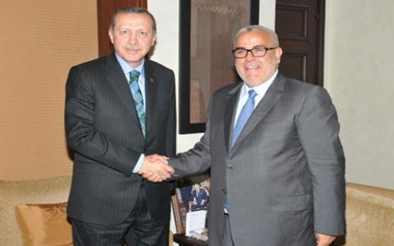 Turkish Prime Minister Recep Tayyip Erdogan (L) with his Moroccan counterpart Abdelilah Benkirane.  Erdogan praised Moroccans for their transition to democracy, and called for more economic cooperation and balanced trade between the two countries.