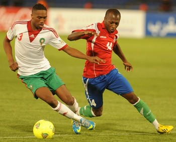 Morocco's Zakarya Bergdich (L) and Sanna Nyassi of Gambia fight for the ball during the FIFA Brazil WC2014 qualifiers match on June 15, 2013 in Marrakech, Morocco.
