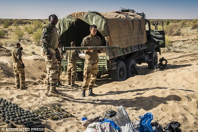 Deadly missile: French soldier holds a SA-7 surface-to-air missile launcher in Timbuktu, Mali. The weapon, which can shoot down military and commercial aircraft, is feared to be in the hands of Al Qaeda after a manual was found at a terror training camp in the town. Photo: AP