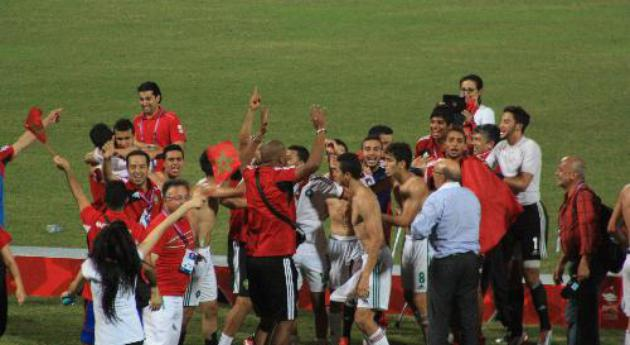 Moroccans celebrate after hard-fought victory over Turkey in penalty shootout