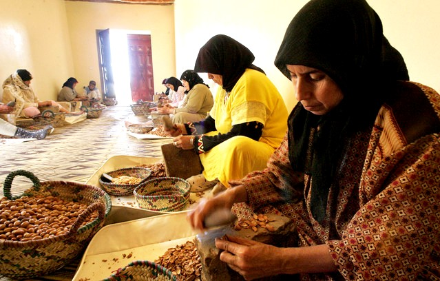 "Moroccan women crush Argan tree nuts to make Argan oil in Smimmou, near Essaouira. The ""Liquid Gold"" for Hair Entices Ex-Goldman Analyst, L'Oreal. Photo: Abdelhak Senna/AFP via Getty Images"