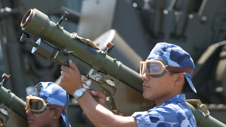 A picture of an SA-7 surface-to-air missile, held by a Nicaraguan on September 2, 2003. / MIGUEL ALVAREZ/AFP/Getty Images