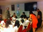 gneufferChildren sit down for lunch in Syriac Orthodox church hall in Acton, London after communion. Amy Assad